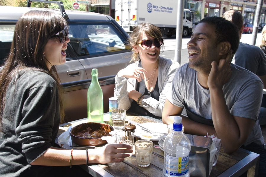A group of young people are enjoying lunch at a cafe on Brunswick Street in Melbourne, Australia. Photographed on 12/10/08 at 12:43 PM.